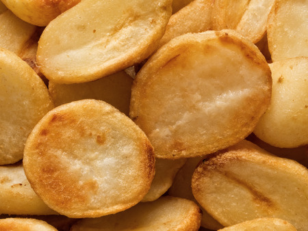 carbs: close up of crispy roasted potato food background Stock Photo