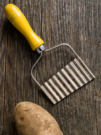 crinkle: close up of a hand crinkle cut potato chipper Stock Photo
