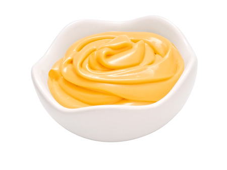 close up of a bowl of texmex cheese sauce dip
