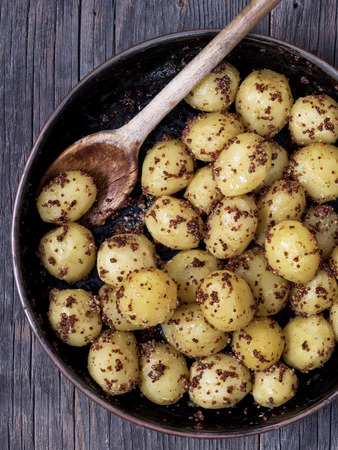 carbs: close up of rustic boiled potato in mustard Stock Photo