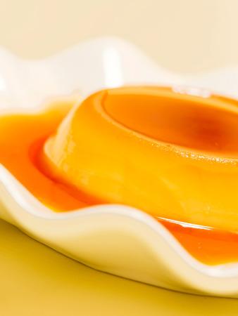 custard flavor: close up of golden rich creme caramel dessert
