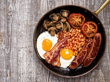 bacon baked beans: close up of rustic full english breakfast