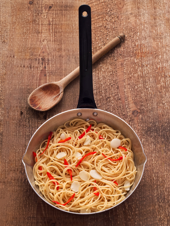 olio: close up of rustic traditional italian aglio olio spaghetti pasta