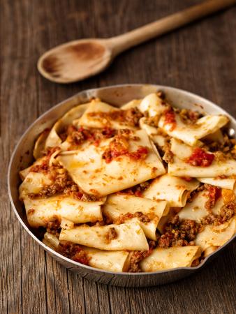 close up of rustic italian pasta in ragu sauce Stock Photo