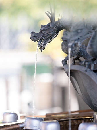 shinto: close up of japanese shinto shrine cleansing fountain