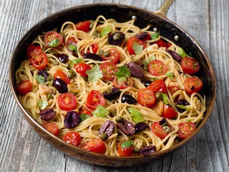puttanesca: close up of rustic italian spaghetti puttanesca pasta Stock Photo