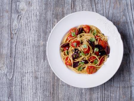 salty: close up of rustic italian spaghetti puttanesca pasta Stock Photo