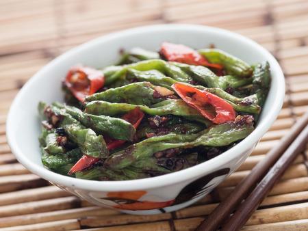 stir up: close up of rustic chinese long snake bean stir fry Stock Photo