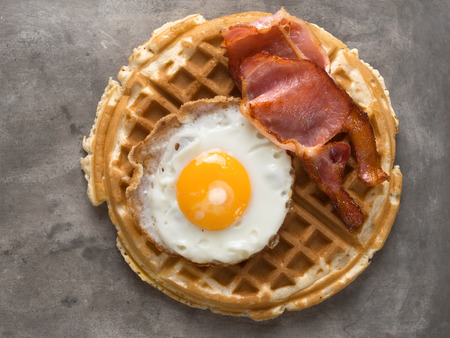 close up of rustic savory bacon and egg waffle