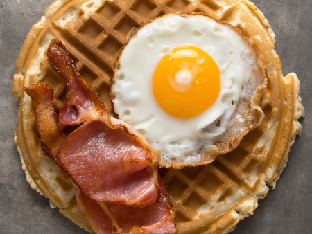 and savory: close up of rustic savory bacon and egg waffle