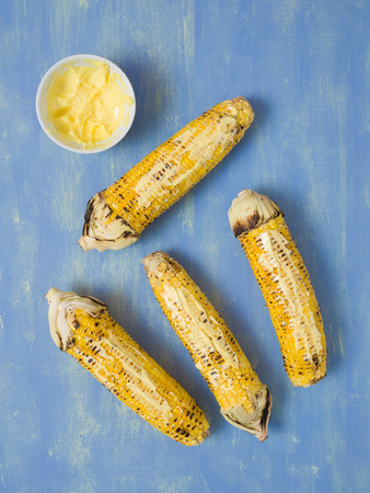 barbie: close up of rustic grilled golden corn cob