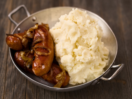grub: close up of rustic english pub grub bangers and mash