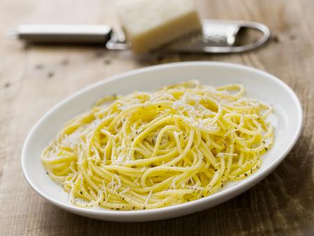 pepe: close up of rustic italian pepe e cacio pepper with cheese spaghetti