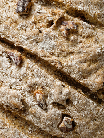 crust: close up of rustic artisan walnut bread crust background Stock Photo