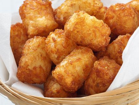 tots: close up of rustic golden potato tater tots Stock Photo