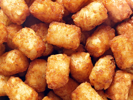 tots: close up of rustic golden potato tater tots food background Stock Photo