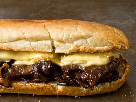 hoagie: close up of rustic philly cheese steak sandwich