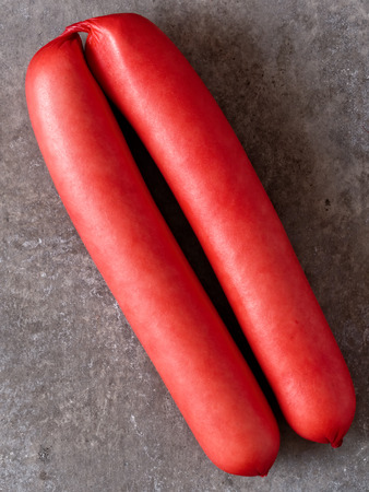 carcinogen: close up of rustic english saveloy red pork sausage