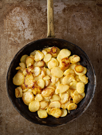 close up of rustic golden german pan fried potato bratkartofflen Stock Photo