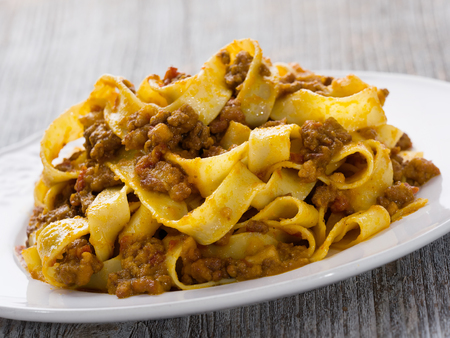 close up of rustic traditional italian pappardelle bolognese
