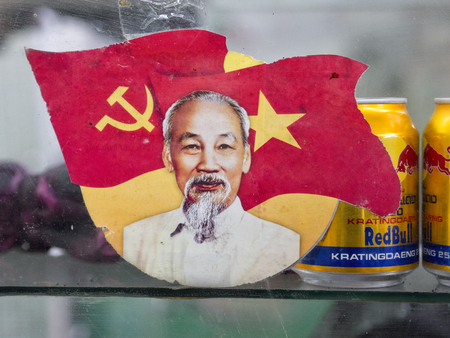 hue, vietnam - january 1, 2017: portrait of ho chi minh in the market in hue, vietnam Editorial