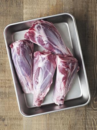 lamb shank: close up of rustic uncooked lamb shank