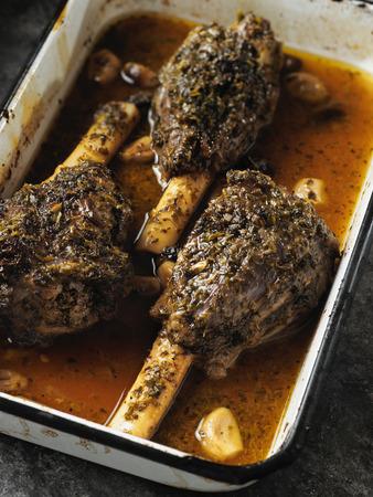 close up of rustic greek roasted lamb shank