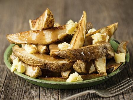 close up of rustic canadian poutine Imagens
