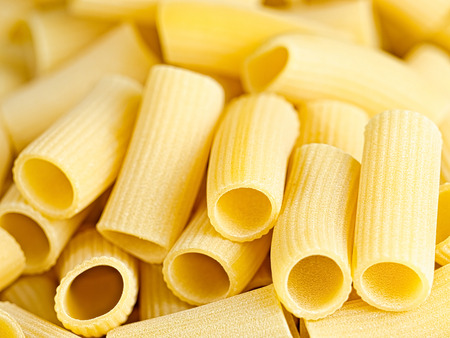ridged: close up of uncooked italian rigatoni pasta
