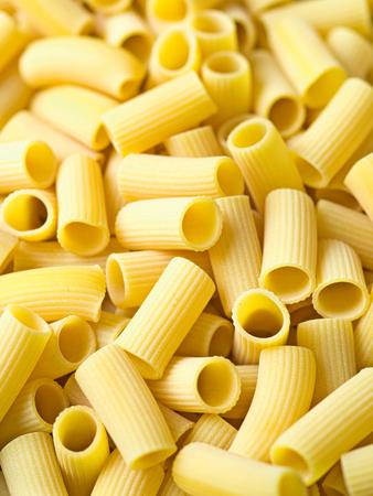 close up of uncooked italian rigatoni pasta