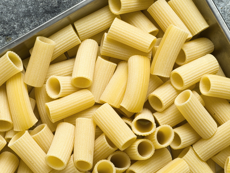 ridged: close up of rustic uncooked italian rigatoni pasta