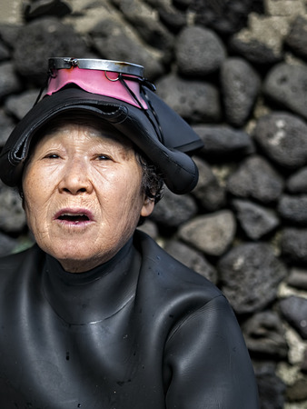 jeju, south korea - 3rd november 2017: haenyeo traditional female fishing divers of jeju island. they considered a national treasure. The majority of the divers are above 50 years old with the oldest being 80.