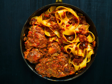 close up of rustic italian oxtail ragu pappardelle pasta Stock Photo - 95921273
