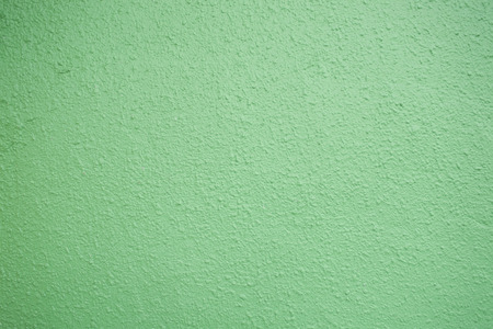 close up of pastel green plastered wall texture background