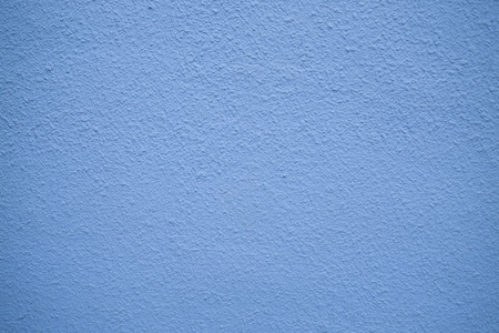 close up of pastel blue plastered wall texture background