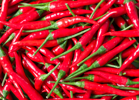close up of bright red bird eye chili food background Stock Photo