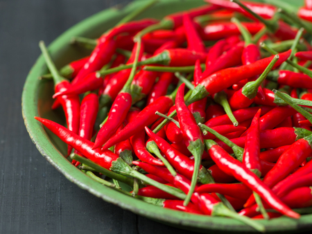 close up of rustic red bird eye chilies Stock Photo
