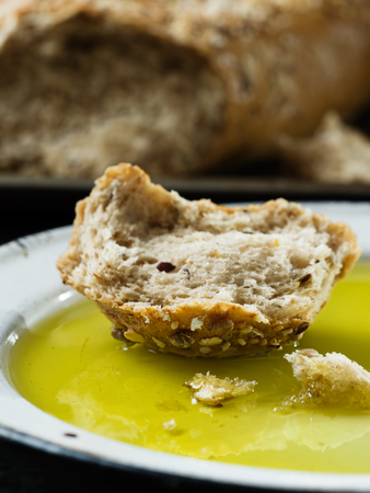 close up of rustic crusty bread with olive oil dip
