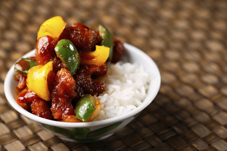 close up of bowl of chinese sweet and sour pork rice
