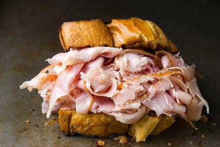 close up of rustic deli ham sandwich