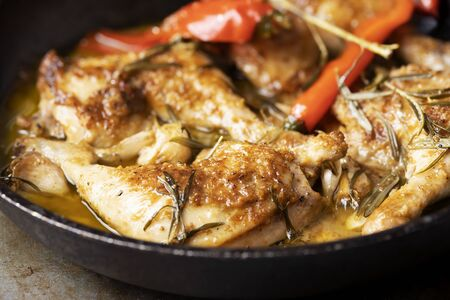 close up of rustic italian golden tuscan chicken
