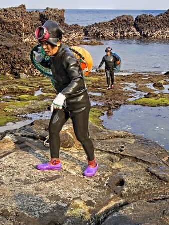 Jeju, South Korea - 3rd November 2017: haenyeo traditional female fishing divers of jeju island. they considered a national treasure. The majority of the divers are above 50 years old with the oldest being 80. Redactioneel