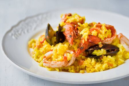 close up of rustic spanish seafood paella