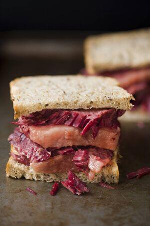 close up of rustic american reuben corned beef sandwich
