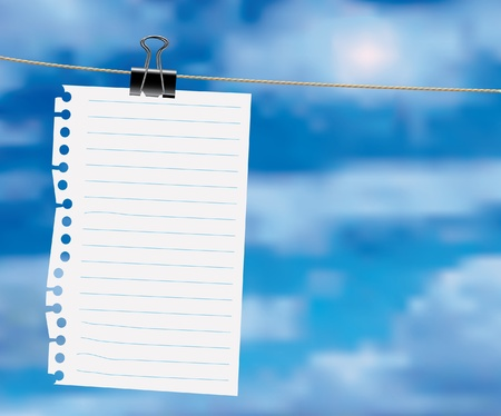 a sheet of paper: paper sheet on a clothes line with clouds