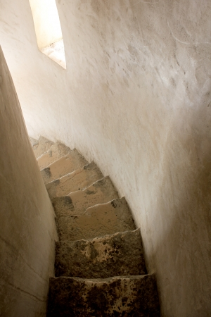stone spiral stairs in tower photo