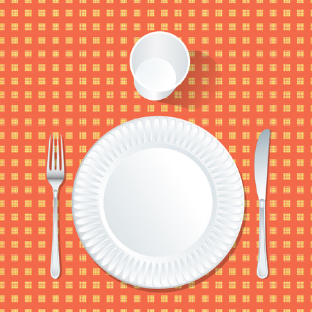checked: paper plate with plastic glass on red and yellow tablecloth