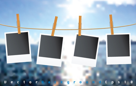 vector blank photos on rope with blurry clouds Vector