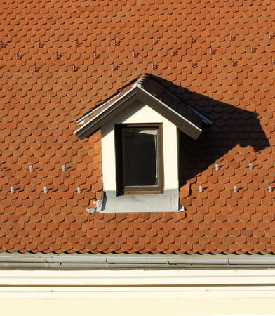 dormer: Little dormer and a new roof with roofing tile Editorial