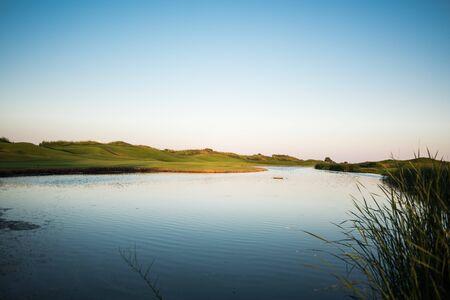 Lake hazard at the golf course at sunset